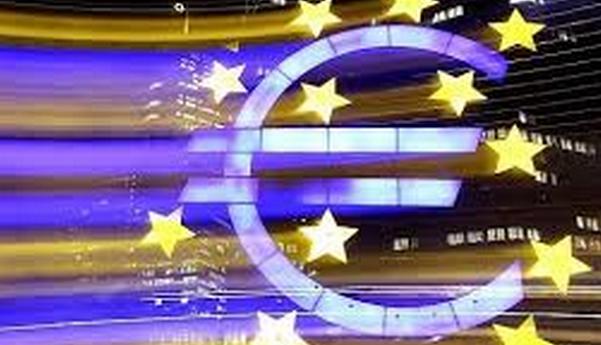 simbolo dell'euro e sullo sfondo alcuni segni della bandiera europea