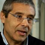 Cuffaro, Rebibbia, carcere, l'ex presidente della Regione Sicilia con occhiali da vista e maglione blu